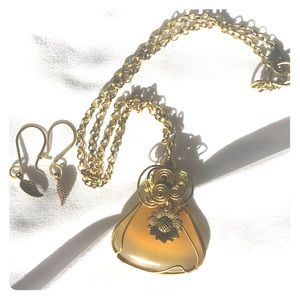 Sunflower necklace with matching leaf earrings.